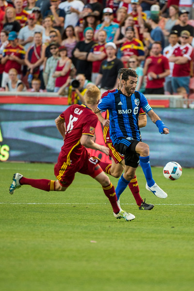 Ignacio Piatti (10), of the Montreal Impact, works to maneuver the ball down field against  Real Salt Lake player, Justen Glad (14), at Rio Tinto Stadium in Sandy, Utah on July 9, 2016.