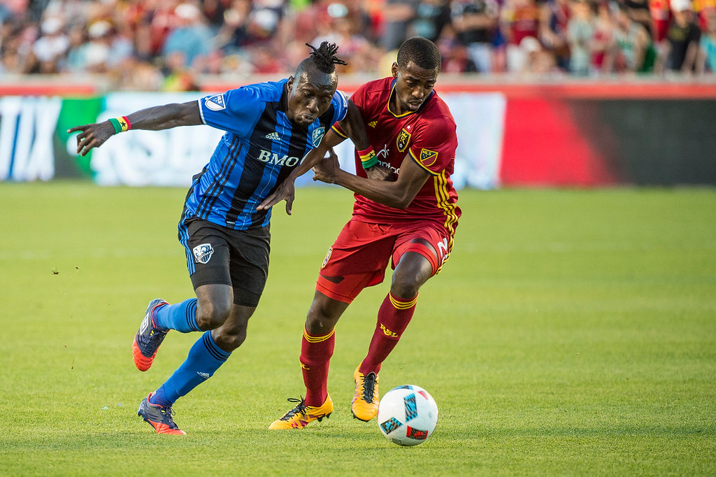 Montreal forward, Dominic Oduro (7), works to get to the goal against the defense of Tony Beltran (2), of Real Salt Lake, at Rio Tinto Stadium in Sandy, Utah on July 9, 2016.