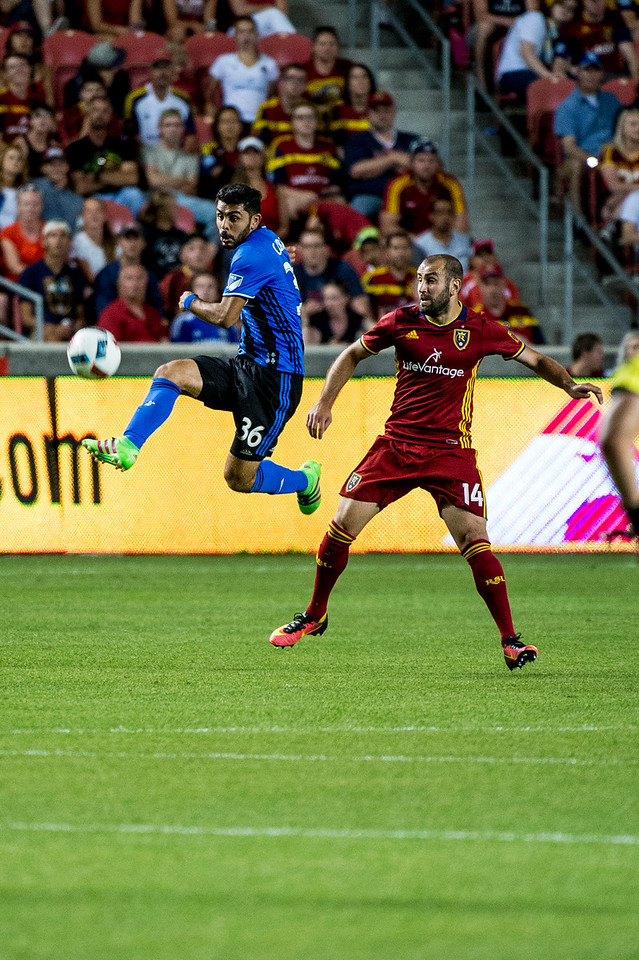 Victor Cabrera (36) leaps into the air to take control of the ball in front of Real Salt Lake player, Yura Movsisyan (14), during the final minutes of a 1-1 tie game at Rio Tinto Stadium in Sandy, Utah on July 9, 2016.