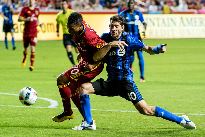 Ignacio Piatti (10), of the Montreal Impact, gets tangled up with Real Salt Lake player, Jordan Allen (70), in the goal box, at Rio Tinto Stadium in Sandy, Utah on July 9, 2016.