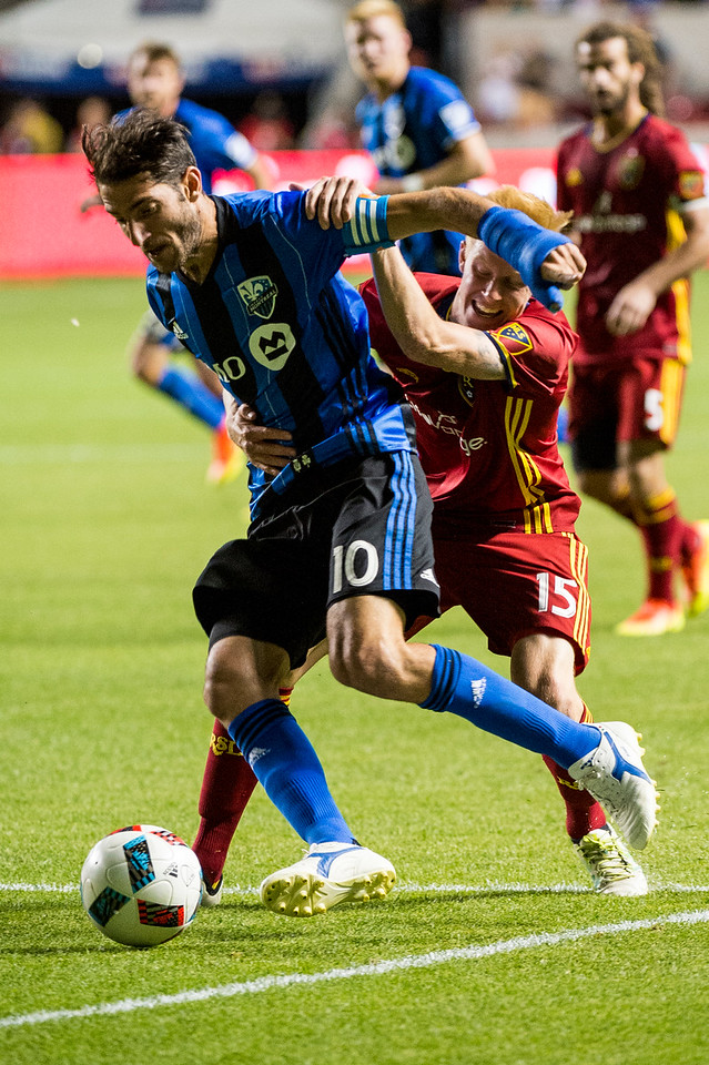 Ignacio Piatti (10), of the Montreal Impact, fights for control of the ball with Real Salt Lake player, Justen Glad (15), near the goal box, at Rio Tinto Stadium in Sandy, Utah on July 9, 2016.