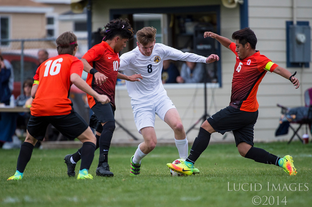 Joe Cloward (8), of Bonneville High, works to advance the ball further into Ogden's territory, but is quickly surrounded by three Ogden players, Mads Dalbram (16), Gabby Sanchez (10), and Bryan Valasco-Perez (15), at Bonneville High School, in Washington Terrace, on Tuesday, April 11, 2017.
