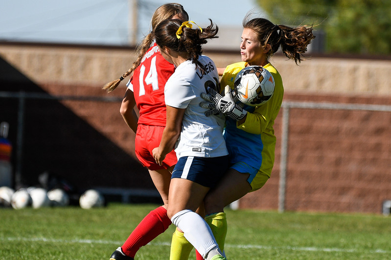 Park City's goalie, Emme Keizer (00), was kept busy all game by the relentless offense and scoring of Bonneville High, shown here blocking the ball from the shot attempt of Isabel Togisala (36), at Bonneville High School, in Washington Terrace, on Wednesday, September 27, 2017. Bonneville won the game 8-2 in an impressive offensive effort that lasted the whole game.