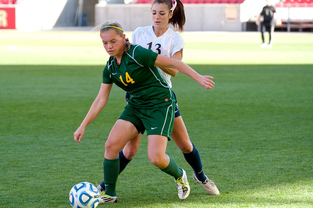 Amanda Higgs of St. Joseph High School dribbles the ball away from Sydney Harrison of Waterford High at Rio Tinto Stadium. (ROBBY LLOYD/Special to the Standard-Examiner)