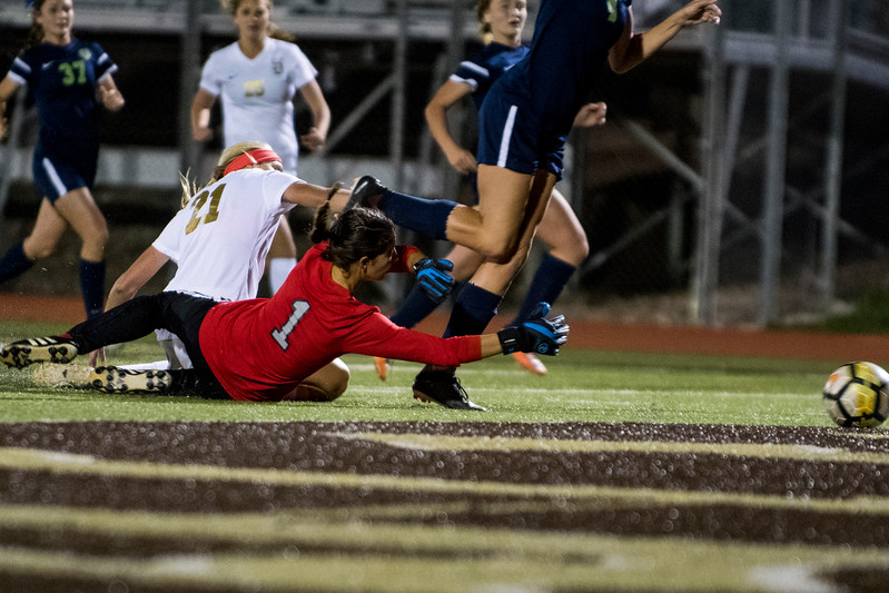 Olivia Griffin (21), of Davis, barely misses the goal after aggressively driving towards Syracuse goalie, Gabby Segura (1), at Davis High School, in Kaysville, on Tuesday, September 26, 2017.