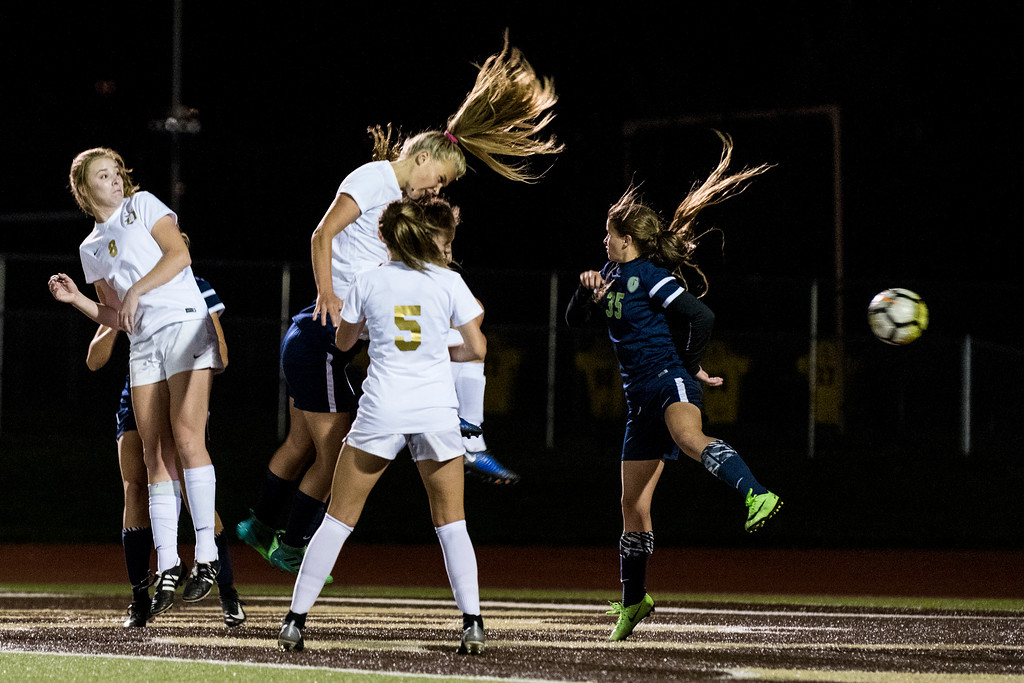 Olivia Romney (17), of Davis High, narrowly misses scoring on a header from a corner kick against the defense of Caroline Stringfellow (35), at Davis High School, in Kaysville, on Tuesday, September 26, 2017.
