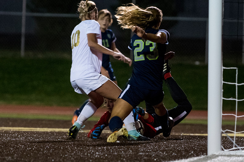 Syracuse goalie, Gabby Segura (1), comes up with a tough save against the goal attempt of Sami Bates (10), of Davis, at Davis High School, in Kaysville, on Tuesday, September 26, 2017.
