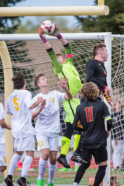 Tanner Kennard (1), of Davis High, saves a well placed ball from getting past him, at Davis High School, in Kaysville, on Tuesday, April 25, 2017. Kennard was kept busy by Viewmont's offense throughout the game, making a number a great saves, but ultimately let one slip past in the final 10 minutes of the game.