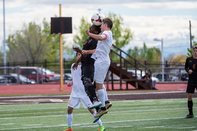 Colton Harrison (7), of Davis High, goes in the air against Mikiyas Lemon (8), of Viewmont, to control the ball in Viewmont's territory, at Davis High School, in Kaysville, on Tuesday, April 25, 2017.
