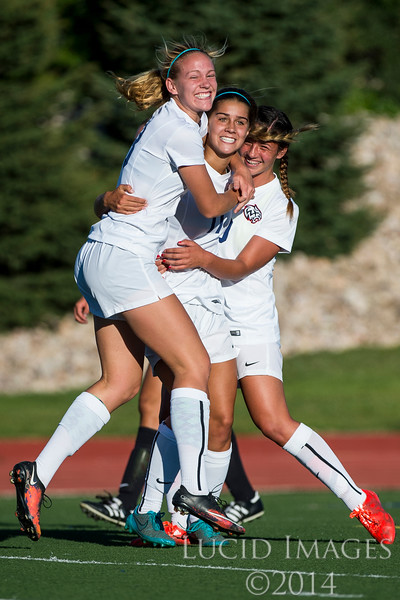 Sara Noel (13, left) and Miya Hammond (9, right) celebrate and congratulate their teammate Olivia Barton (11, center) after she scored the first goal of the game to put Woods Cross up 1-0 against Viewmont High at Woods Cross High School in Woods Cross on August 11, 2016.