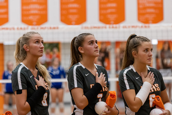 Saige Stahl, Maddie Cline, and Reece Whitehead of The Columbus East vollyball team during the national anthem. Photo by Tony Vasquez for Indy Sports Daily.