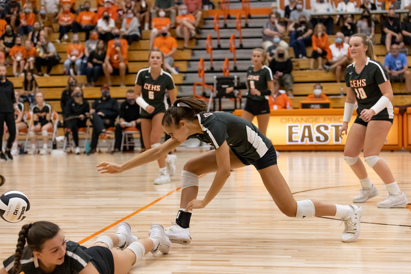 Columbus East's Chole Gilley and Libby Dippold dive for the ball agaisnt the North Bull Dogs on September 30, 2021. Photo by Tony Vasquez for Indy Sports Daily.