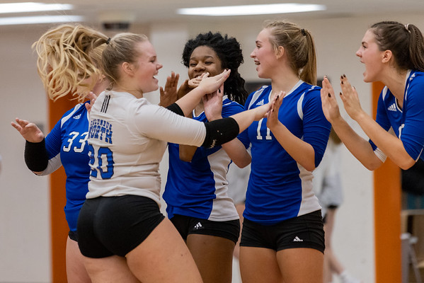 Columbus North Bull Dogs Grace Chapman celebrates with Kaitlyn Mabis during during starting lineup. Photo by Tony Vasquez for Indy Sports Daily.
