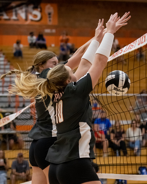 Gabby Dean and Katy Jordan block the North Bull Dogs volley on September 30, 2021. Photo by Tony Vasquez for Indy Sports Daily.