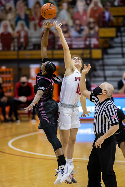 Johnasia Cash faces off with Aleksa Gulbe on the tipoff between the Hoosiers and Lady Lions. Photo by Tony Vasquez for Indy Sports Daily.