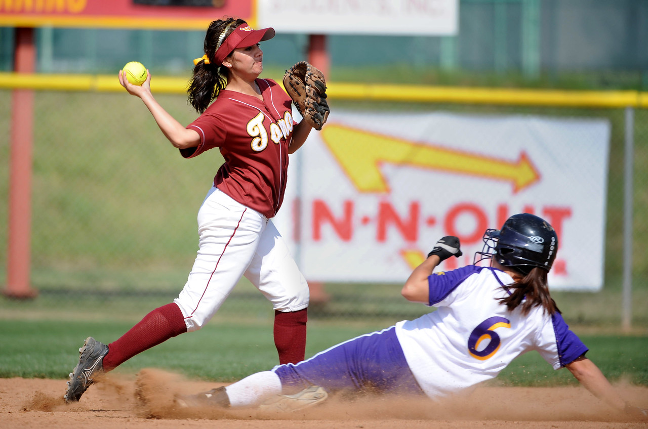 Feb 29, 2008; Carson, CA, USA; Cal State Dominguez Hills Toros shortstop Jennifer Frazier (7) forces out San Francisco State Gators outfielder Karolyn Gubbine (6) at second base during game at Toro Diamond. Mandatory Credit: Kirby Lee/Image of Sport-US PRESSWIRE