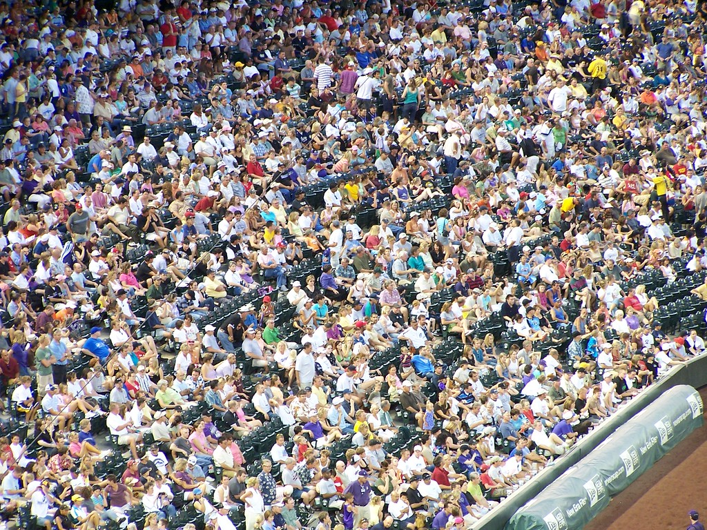 This is using a 10x optical zoom from the upper deck where the full field shots were take.  My husband is down there somewhere.