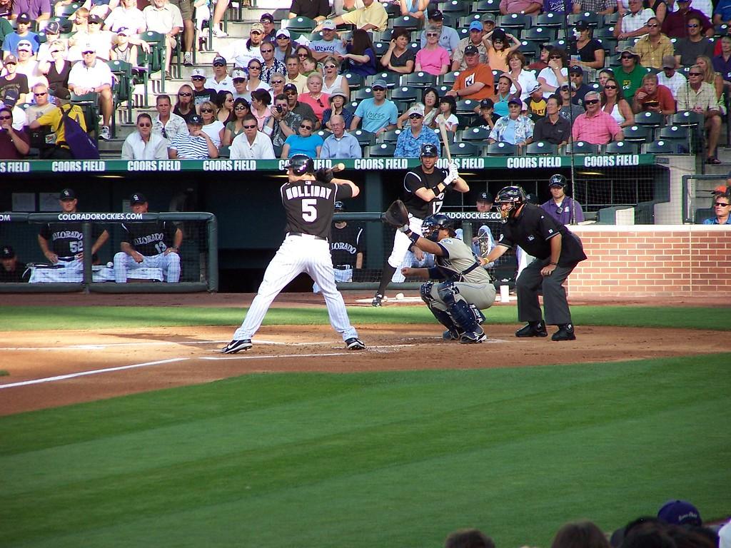 Matt Holliday at bat with Todd Helton swinging along with him.