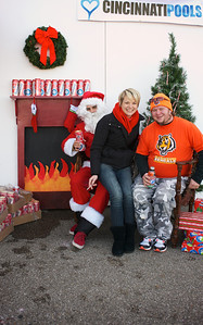 Kate Roeding and Ed Moonitz of Cincinnati with Santa at Longworth hall tailgating before the Bengals game