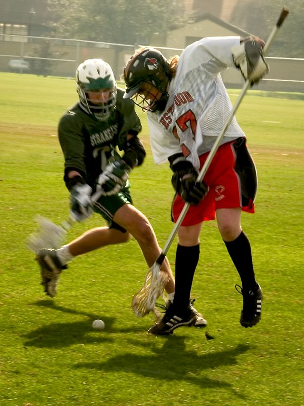 "Shea Pearson, defense, uses the ""D-stick"" effectively on a ground ball."