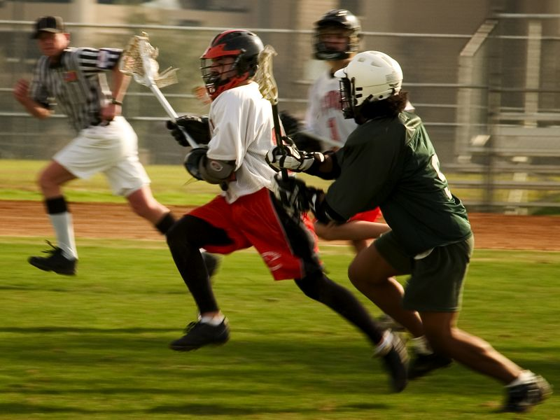 Alex Ierullo, midfield, clears with Strake Jesuit player in pursuit.