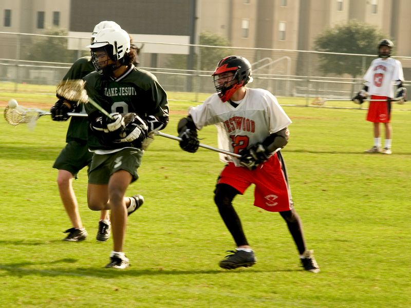 Alex Ierullo, midfield, knocks the ball free with a well-placed stick check.