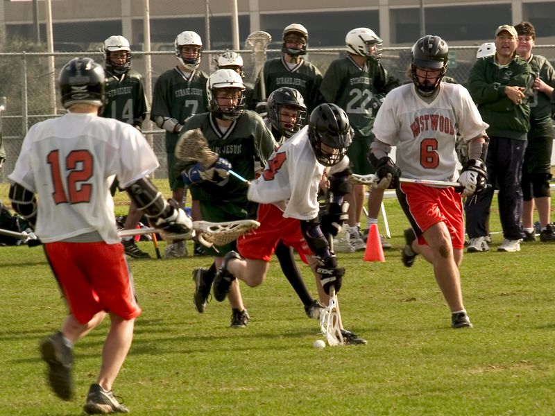 Daniel Miro, attack,  goes after ground ball with Max Heath, defense and Zack Dielmann, attack, in support.