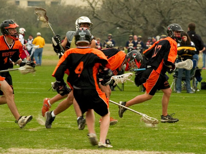 Westwood High School lacrosse team attack moves to regain possession.