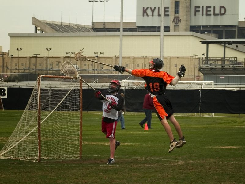 Evan Alexander, attack, airborne as he tries to block the Bellaire goalie's clear.