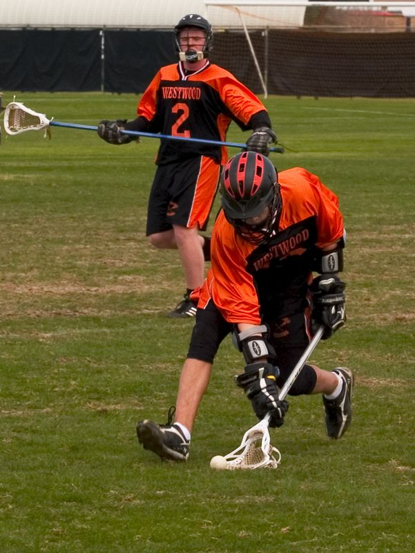 Nathan Ostrout, midfield, scoops ground ball as Michael Becherer watches.