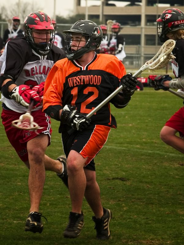 Will Anderson, midfield, drives up the field.