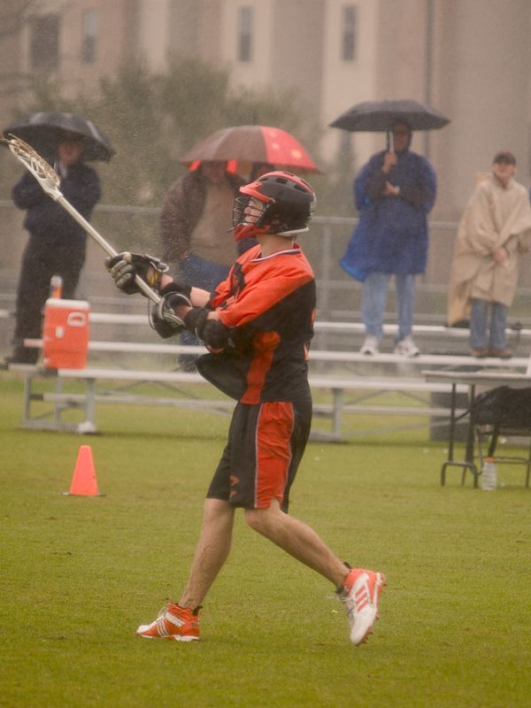 Brendan Murphy, midfield, at point in the pouring rain.