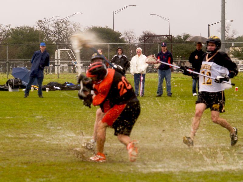 Brendan Murphy, middie,  unloads in the mud.