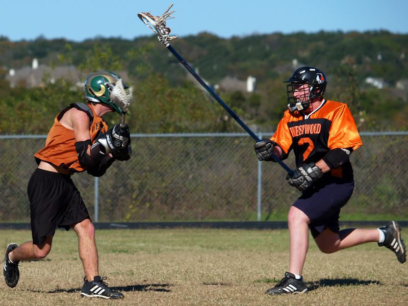 Michael Becherer tries to catch Kevin Lehman (Westwood Class of 2004, Colorado State Lacrosse)