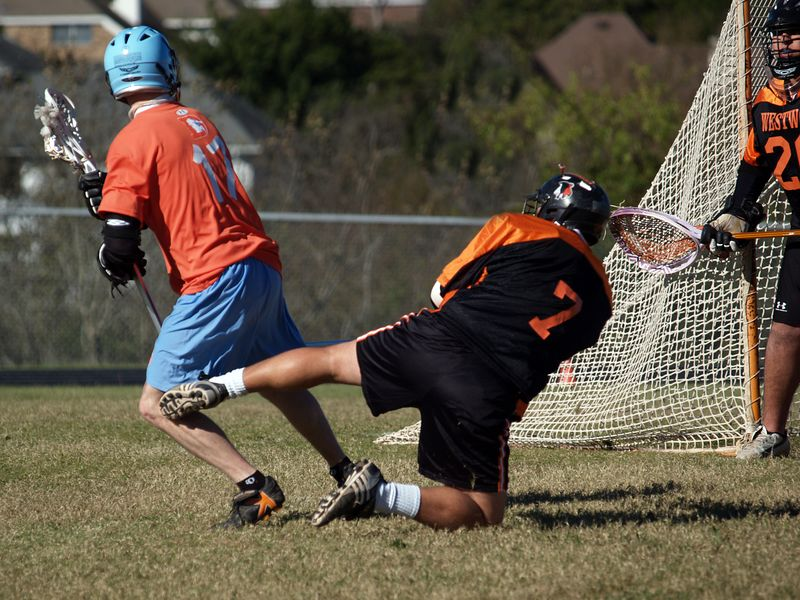 Gavin Rogus defends against unknown alum.
