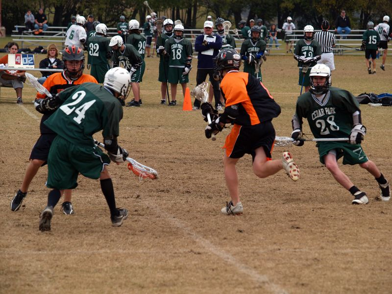 Nathan Ostrout blocks, Ross Gottshall drives.