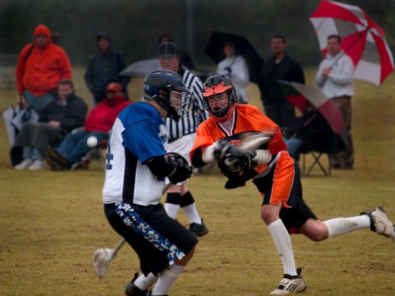 Evan Alexander (attack) shoots around defender.