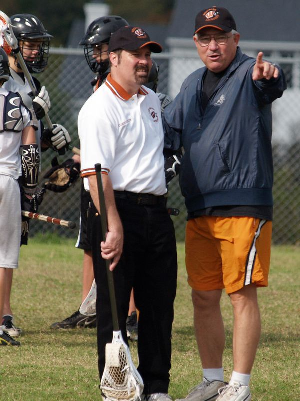 Junior Varsity Coaches Steve Scanlon (left) and Paul Sowada (pointing).