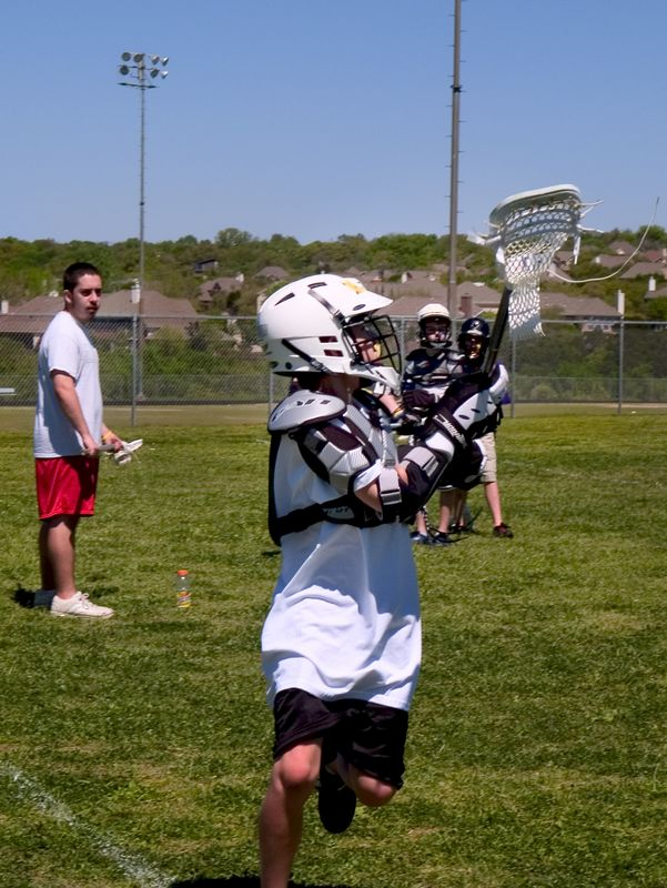 """""""Over-the-shoulder"""" drills as Will Anderson, Westwood midfielder encourages participants."""
