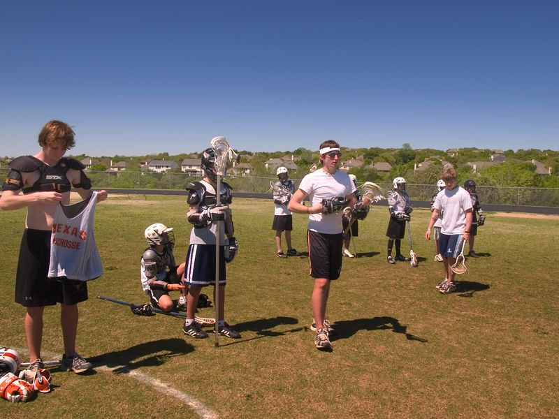 7th and 8th graders work with UT and Westwood players in an early afternoon drill.