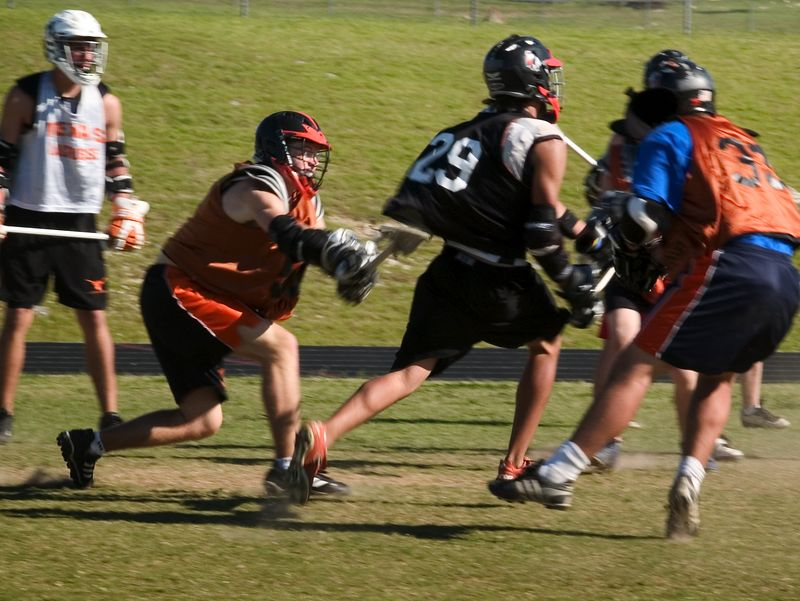 Brendan Murphy, Pearson Suniga, and Gavin Rogus mix it up during the afternoon scrimmage.