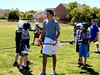 Amir Mozafuri, sophomore midfielder for the University of Texas' lacrosse team, instructs 5th and 6th graders at the Youth Clinic on 2 April 2005.