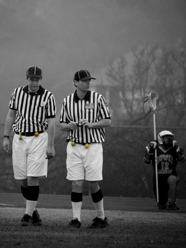 Lacrosse referees, flags.