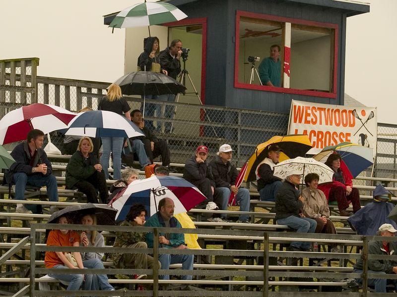 A rain-soaked but loyal crowd at the Westwood Varsity season opener.