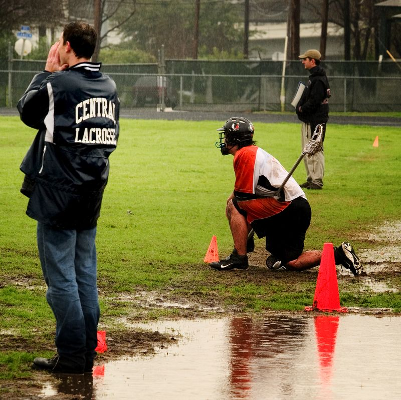 """Jeff Johnson takes a knee in the """"sin bin"""" trying to avoid another of the many puddles."""