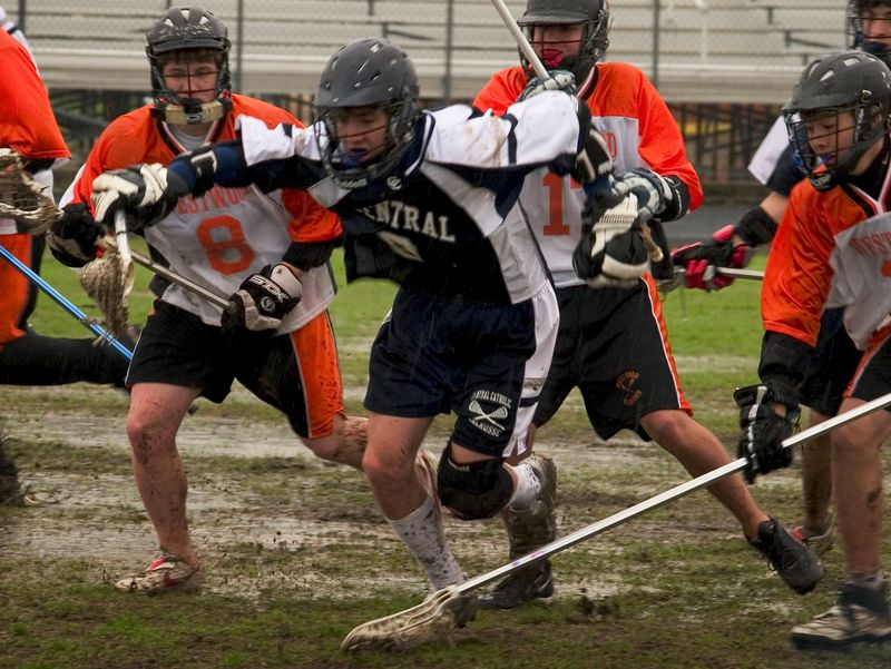 Ross, David and Tye start after Central Catholic after a ground ball.