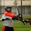 Gavin Rogus passes the ball up field while taking a stick check.