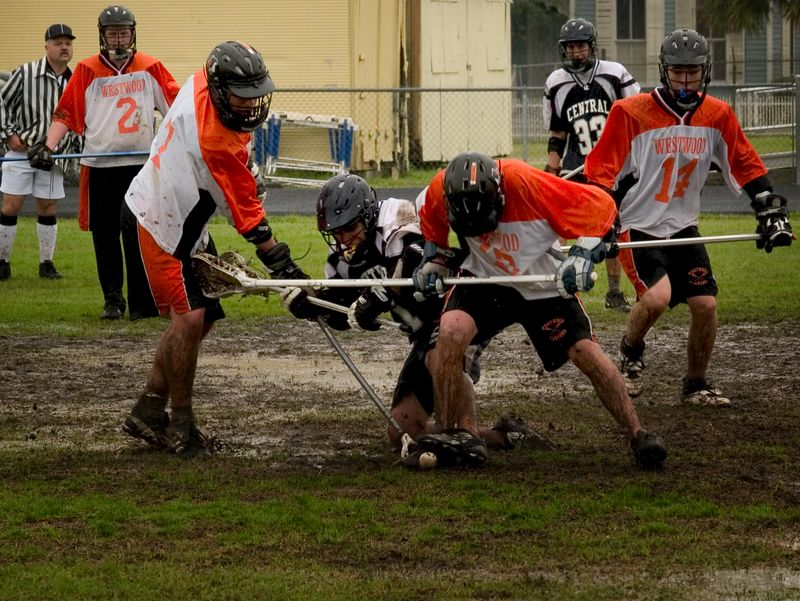 Rogus and Gautier push the man out for the ground ball.