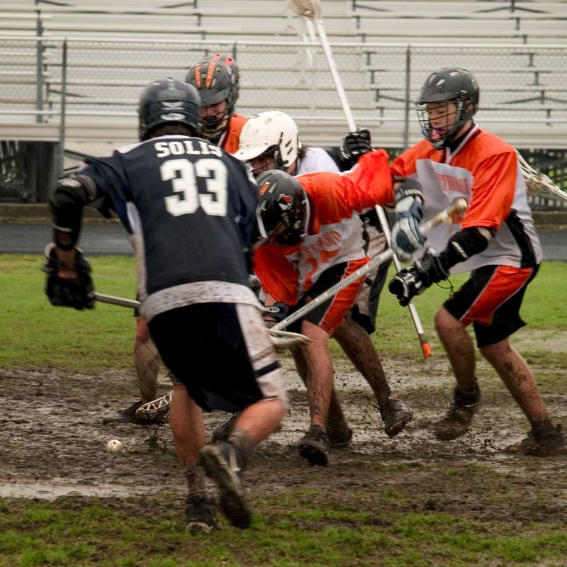 Gautier and Garrison fight in the mud for the ground ball as Tye Hetherington comes in from behind with help.