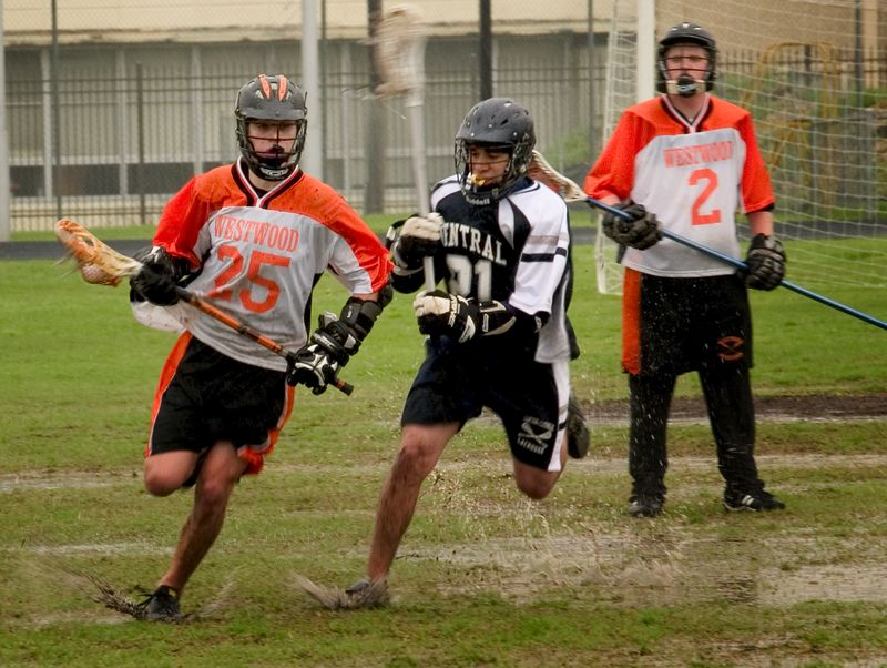 Sam Garrison drives up the field as Becherer looks on.